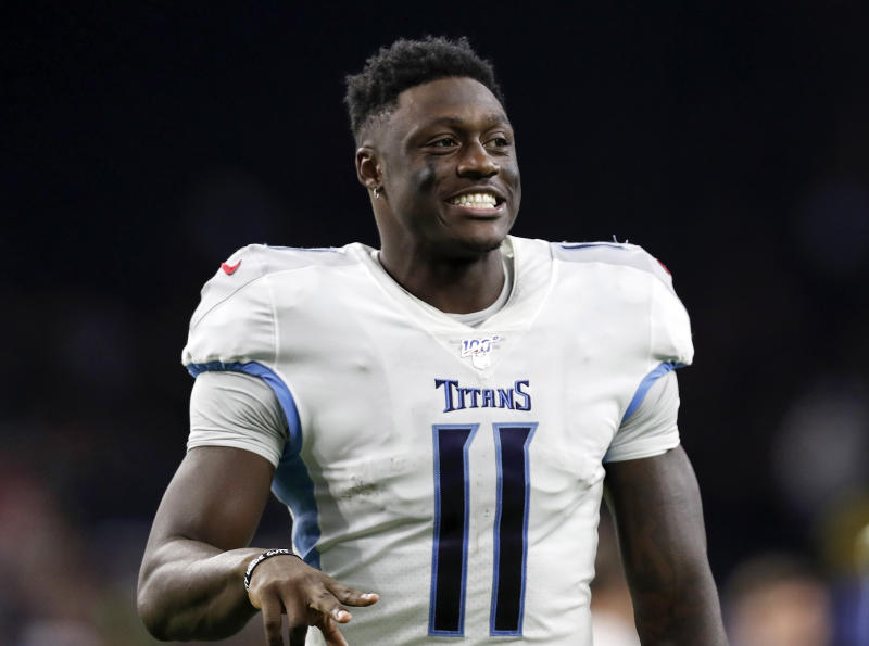 HOUSTON, TX - DECEMBER 29: A.J. Brown #11 of the Tennessee Titans celebrates on the way to the locker room after the game against the Houston Texans at NRG Stadium on December 29, 2019 in Houston, Texas. (Photo by Tim Warner/Getty Images)