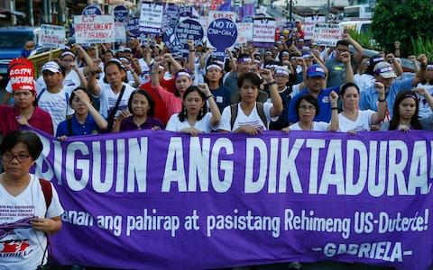 Protesters mark International Women's Day in downtown Manila, calling Philippine President Rodrigo Duterte among the worst violators of women's rights in Asia - Credit: Bullit Marquez/AP