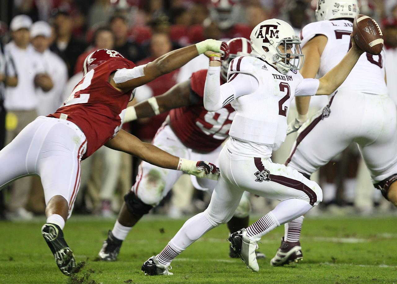 TUSCALOOSA, AL - NOVEMBER 10:  Quarterback Johnny Manziel #2 ofthe Texas A&M Aggies breaks away from linebacker Adrian Hubbard #42 of the Alabaman Crimson Tide during the game at Bryant-Denny Stadium on November 10, 2012 in Tuscaloosa, Alabama.  (Photo by Mike Zarrilli/Getty Images)