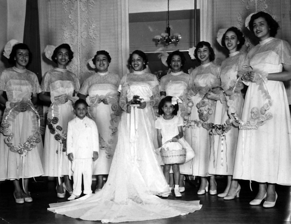 """<p>This adorable bridal party wouldn't look out of place in a modern ceremony, from the simple strapless bridesmaids gowns (worn with sheer capelets) to their fun fascinators. </p><p><a href=""""http://www.goodhousekeeping.com/home/g283/bridal-shower-gifts/"""" rel=""""nofollow noopener"""" target=""""_blank"""" data-ylk=""""slk:20 perfect bridal shower gift ideas »"""" class=""""link rapid-noclick-resp""""><em>20 perfect bridal shower gift ideas »</em></a></p>"""