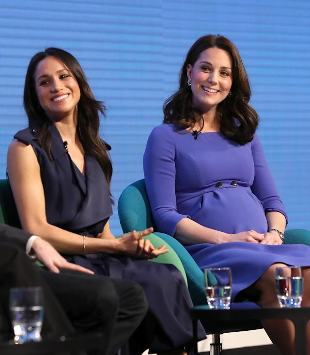 Both Markle and Middleton wore blue for the occasion. (Photo: Getty)