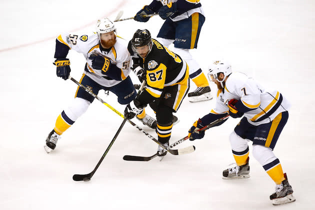 "PITTSBURGH, PA – JUNE 08: <a class=""link rapid-noclick-resp"" href=""/nhl/players/3737/"" data-ylk=""slk:Sidney Crosby"">Sidney Crosby</a> #87 of the <a class=""link rapid-noclick-resp"" href=""/nhl/teams/pit/"" data-ylk=""slk:Pittsburgh Penguins"">Pittsburgh Penguins</a> is defended by <a class=""link rapid-noclick-resp"" href=""/nhl/players/4881/"" data-ylk=""slk:Matt Irwin"">Matt Irwin</a> #52 and <a class=""link rapid-noclick-resp"" href=""/nhl/players/4537/"" data-ylk=""slk:Yannick Weber"">Yannick Weber</a> #7 of the <a class=""link rapid-noclick-resp"" href=""/nhl/teams/nas/"" data-ylk=""slk:Nashville Predators"">Nashville Predators</a> during the second period in Game Five of the 2017 NHL Stanley Cup Final at PPG PAINTS Arena on June 8, 2017 in Pittsburgh, Pennsylvania. (Photo by Gregory Shamus/Getty Images)"