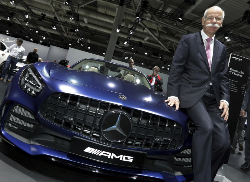 Daimler CEO Dieter Zetsche poses prior to the annual shareholder meeting of the car manufacturer Daimler in Berlin, Germany, Wednesday, May 22, 2019. (AP Photo/Michael Sohn)