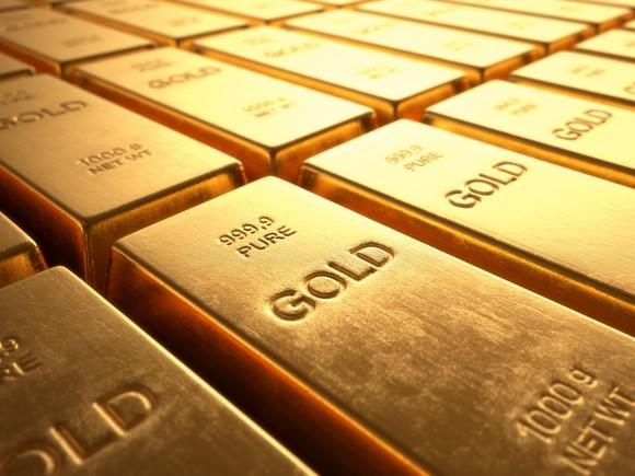Rows of gold bars lying next to each other.