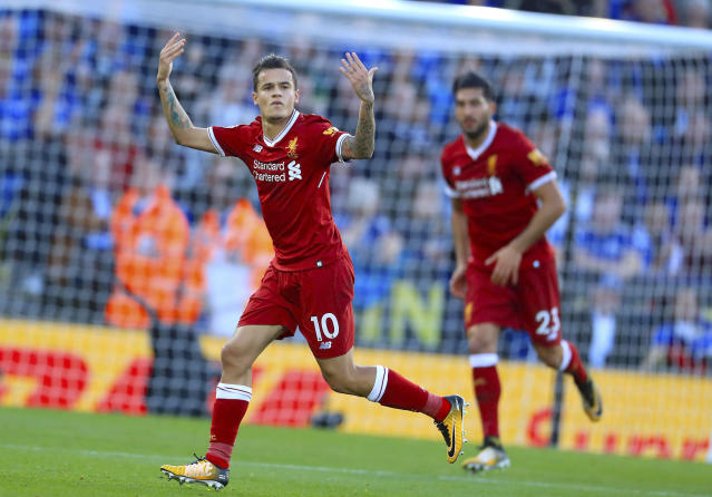 """<a class=""""link rapid-noclick-resp"""" href=""""/soccer/teams/liverpool/"""" data-ylk=""""slk:Liverpool"""">Liverpool</a>'s <a class=""""link rapid-noclick-resp"""" href=""""/soccer/players/philippe-coutinho/"""" data-ylk=""""slk:Philippe Coutinho"""">Philippe Coutinho</a>, left, celebrates scoring his side's second goal of the game during the Premier League soccer match. <a class=""""link rapid-noclick-resp"""" href=""""/soccer/teams/leicester-city/"""" data-ylk=""""slk:Leicester City"""">Leicester City</a> versus Liverpool at the King Power Stadium, Leicester, England, Saturday Sept. 23, 2017. (Mike Egerton/PA via AP)"""