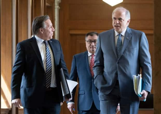 'Even if you're rich, nobody wants to lose a million,' Legault said of the potential losses Fitzgibbon, right, was facing if he sold his shares in the two companies.