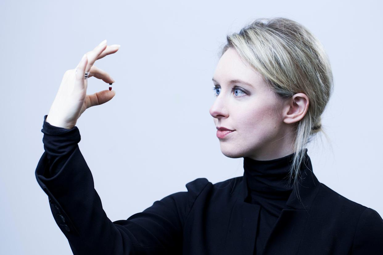 Theranos Founder and CEO Elizabeth Holmes, 29, is photographed holding a nanotainer of blood at Theranos headquarters in Palo Alto, CA on Monday, June 30, 2014.  Holmes dropped out of the engineering program at Stanford because she had bigger plans: now 29, she's the founder of Theranos, a high-tech venture that aims to radically simplify health monitoring through blood analysis. (Photo by Martin E. Klimek/USA Today Network/Sipa USA)