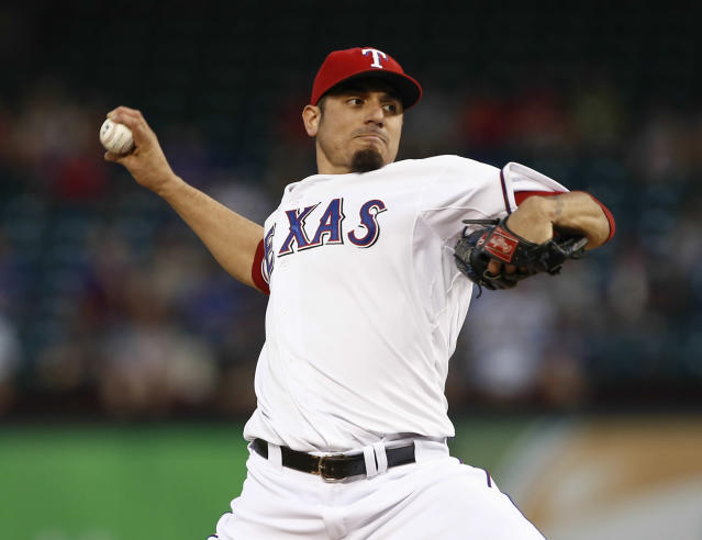 FILE - In this Sept. 26, 2013 file photo, Texas Rangers starting pitcher Matt Garza delivers a pitch to the Los Angeles Angels during the first inning of a baseball game in Arlington, Texas. Garza signed a four-year contact with the Milwaukee Brewers on Sunday, Jan. 26, 2014. (AP Photo/Jim Cowsert, File)