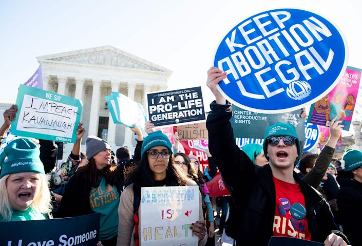 Pro-choice activists supporting legal access to abortion protest during a demonstration outside the US Supreme Court in Washington, D.C., in 2020.