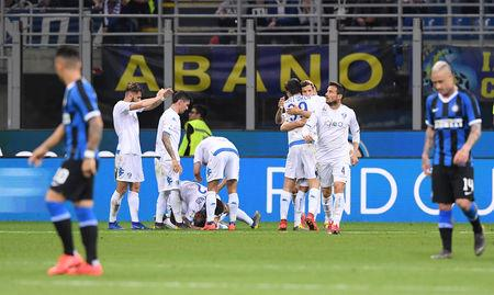 Soccer Football - Serie A - Inter Milan v Empoli - San Siro, Milan, Italy - May 26, 2019   Empoli's Hamed Junior Traore celebrates scoring their first goal with Giovanni Di Lorenzo and team mates   REUTERS/Alberto Lingria