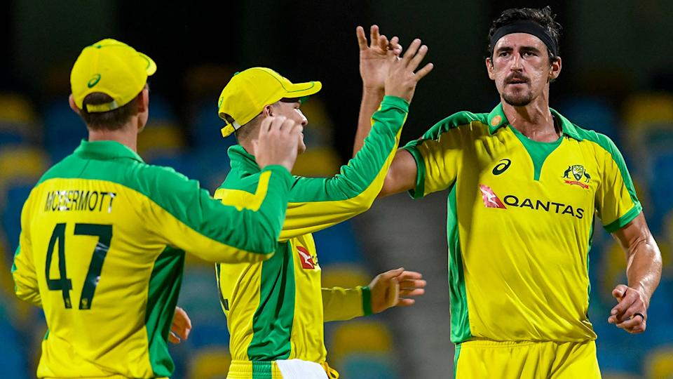 Mitchell Starc, pictured here celebrating the dismissal of Darren Bravo in the second ODI.