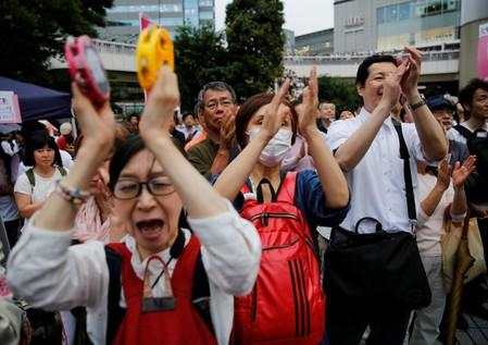 People applaud as they watch an election rally of Reiwa Shinsengumi's candidates for Japan's July 21 upper house election, in Tokyo