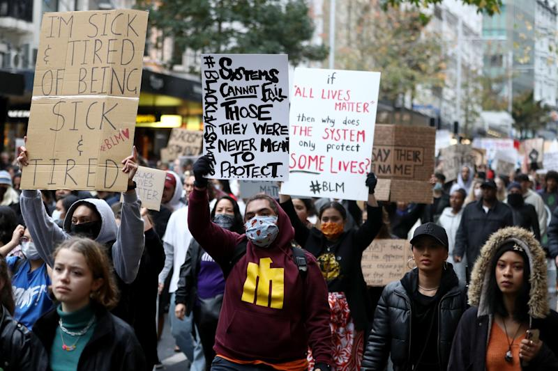 AUCKLAND, NEW ZEALAND - JUNE 01: Protestors march down Queen Street on June 01, 2020 in Auckland, New Zealand. The rally was organised in solidarity with protests across the United States following the killing of an unarmed black man George Floyd at the hands of a police officer in Minneapolis, Minnesota. (Photo by Hannah Peters/Getty Images) (Photo: Hannah Peters via Getty Images)