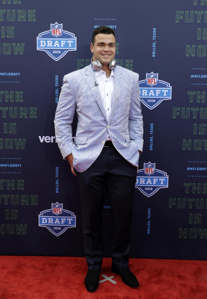 <p>Texas's Connor Williams poses for photos on the red carpet before the first round of the NFL football draft, Thursday, April 26, 2018, in Arlington, Texas. (AP Photo/Eric Gay) </p>