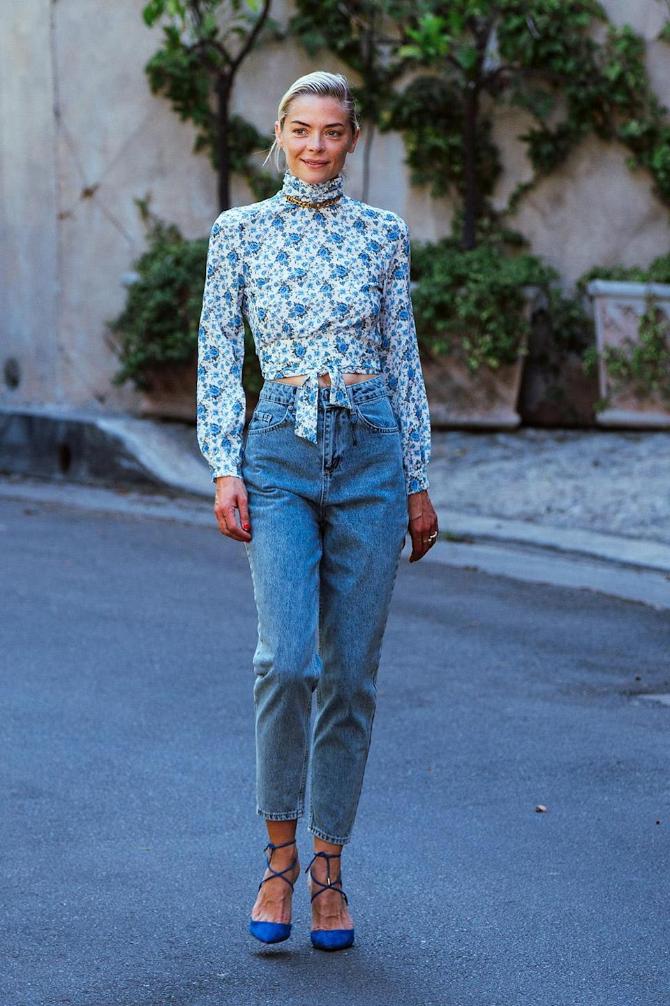 <p>Jaime King stepped out from her Los Angeles home Thursday in a chic boohoo floral backless top and high-waisted jeans.</p>