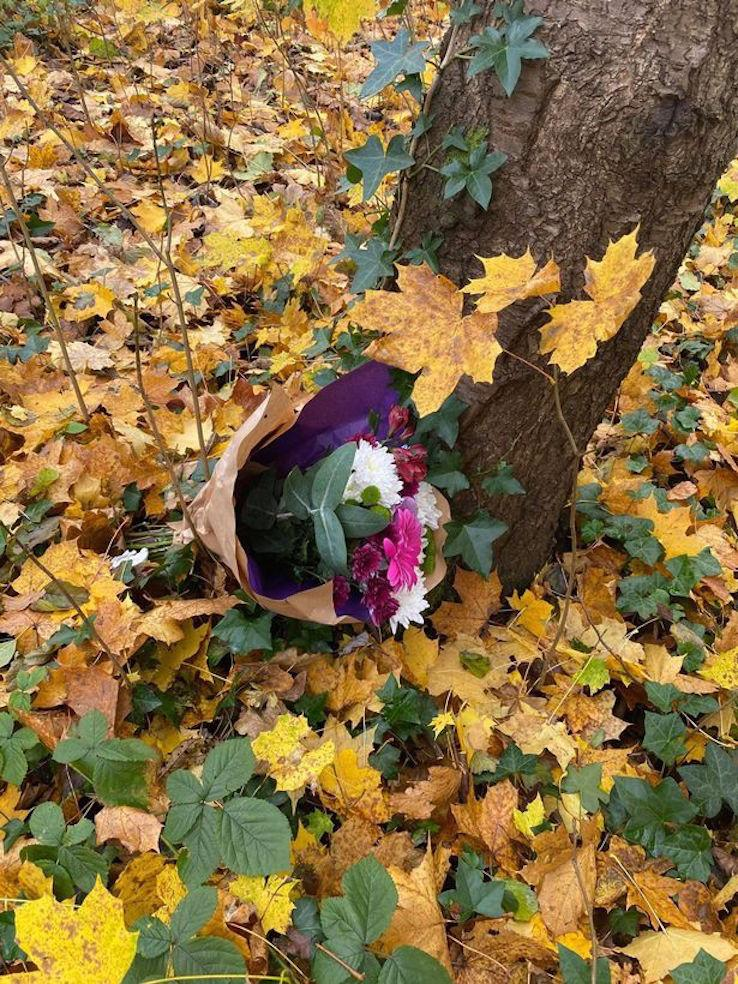 A floral tribute is left in a wooded area of Moston, Manchester. (Reach)