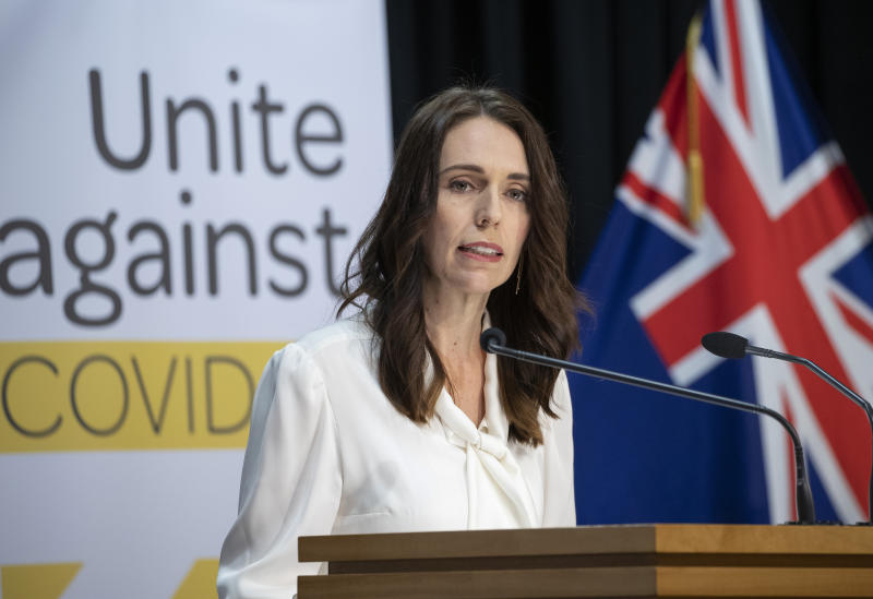 New Zealand's Prime Minister Jacinda Ardern address a press conference at the post-cabinet media conference at Parliament, in Wellington, New Zealand, Monday, April 20, 2020. Ardern on Monday announced the country will remain in a strict lockdown for another week before easing the rules to allow some parts of the economy to reopen. (Mark Mitchell/Pool photo via AP)