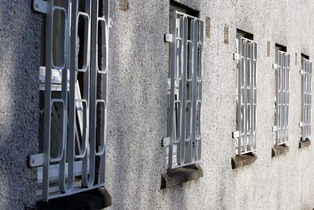 Barred windows at a prison (Andrew Milligan/PA)