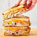 """<p>Tuna lovers! Meet your ultimate sandwich. With just the right amount of crunch, melty cheddar cheese, and a couple good slices of tomato, you might even convert a tuna hater. </p><p>Get the <a href=""""https://www.delish.com/uk/cooking/recipes/a29185033/tuna-melt-recipe/"""" rel=""""nofollow noopener"""" target=""""_blank"""" data-ylk=""""slk:Tuna Melt"""" class=""""link rapid-noclick-resp"""">Tuna Melt</a> recipe.</p>"""