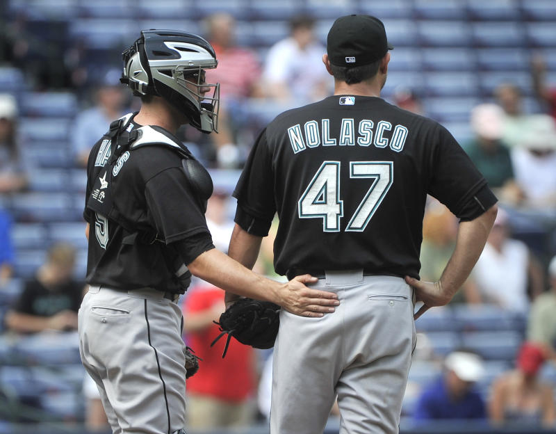 Florida Marlins starting pitcher Ricky Nolasco (47) is settled by catcher Brett Hayes after Atlanta Braves' Martin Prado bunted in a run in the seventh inning of a baseball game, Wednesday, Sept. 14,  2011, in Atlanta. Atlanta won 4-1. (AP Photo/John Amis)