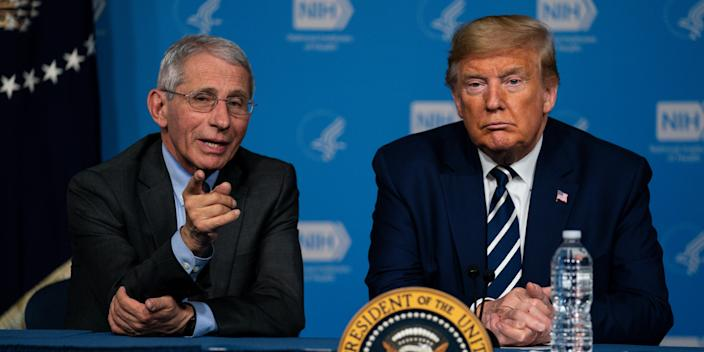 President Donald Trump listens to Dr. Anthony Fauci, director of the National Institute of Allergy and Infectious Diseases, during a briefing on the coronavirus at the National Institutes of Health, March 3, 2020, in Bethesda, Maryland.