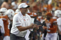 FILE - Texas head coach Tom Herman shouts to his team during the first half of an NCAA college football game against UTEP in Austin, Texas,in this Saturday, Sept. 12, 2020, file photo. When Texas finished its season with consecutive lopsided victories, it seemed that coach Tom Herman would be back for a fifth season despite again falling short of a Big 12 title. There was no reason to think Les Miles would be gone from Kansas, even after a winless second season. Yet, the Longhorns and Jayhawks both went through spring practice with different coaches. (AP Photo/Chuck Burton, File)