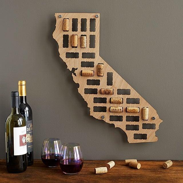 <p>Give them somewhere to store their favorite wine corks with these <span>Wine Cork States<br> </span> ($35), from their anniversary Chardonnay to their birthday Grenache.</p>