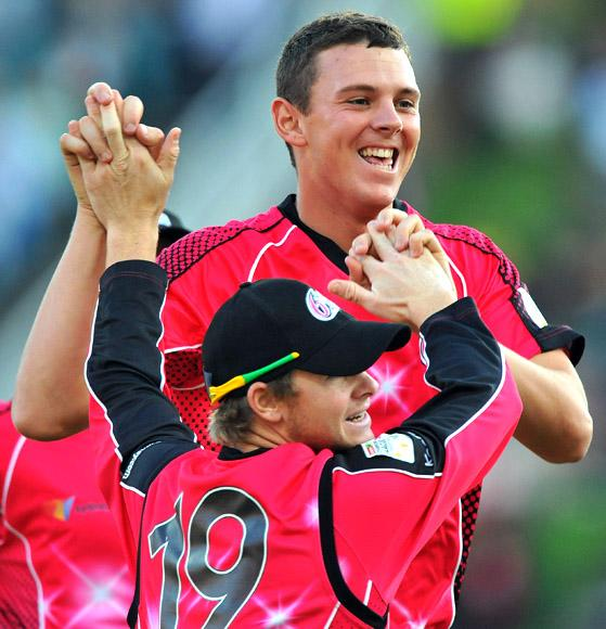 Josh Hazlewood of the Sixers celebrates the wicket of Quinton de Kock of the Lions for 1 run during the Karbonn Smart CLT20 Final match between bizhub Highveld Lions and Sydney Sixers at Bidvest Wanderers Stadium on October 28, 2012 in Johannesburg, South Africa. (Photo by Duif du Toit/Gallo Images/Getty Images)
