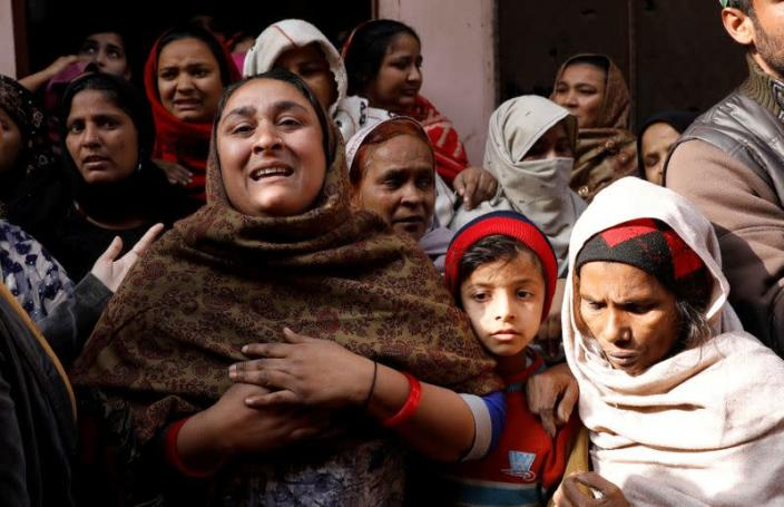 FILE PHOTO: Shaheen, sister of Mohammed Mohsin, who died during clashes with police following protests against a new citizenship law, cries outside their house in Meerut