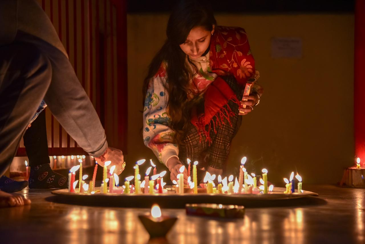 <p>A Kashmiri Hindu girl seen lighting a candle inside a temple on the occasion of Hindu festival Diwali in the outskirts of Srinagar. Diwali, the Hindu festival of lights, marks the triumph of good over evil, and commemorates the return of Hindu deity Rama to his birthplace Ayodhya after victory against the demon king Ravana. (Photo by Idrees Abbas/SOPA Images/LightRocket via Getty Images) </p>