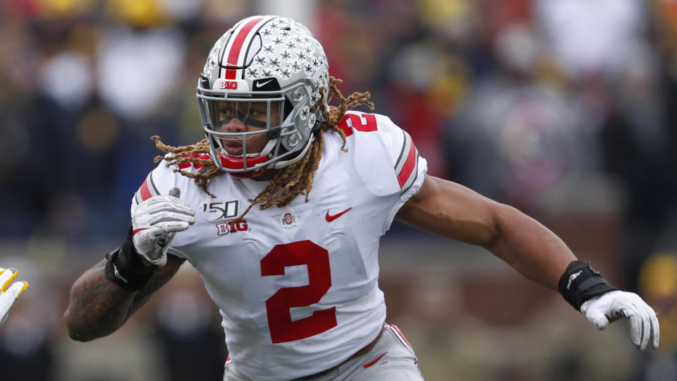 Ohio State defensive end Chase Young plays against Michigan in the first half of an NCAA college football game in Ann Arbor, Mich., Saturday, Nov. 30, 2019. (AP Photo/Paul Sancya)
