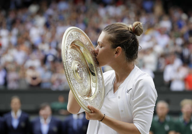 File - In this July 13, 2019, file photo, Romania's Simona Halep kisses the trophy after defeating United States' Serena Williams during the women's singles final match on day twelve of the Wimbledon Tennis Championships in London. Halep enters the U.S. Open ranked No. 4 as she comes off a championship at Wimbledon. (AP Photo/Kirsty Wigglesworth, File)