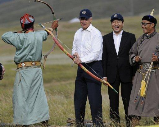 US Vice President Joe Biden (centre) tries his hand at archery as Mongolian Prime Minister Sukhbaatar Batbold (2nd right) laughs during a sporting event staged in Biden's honour in Ulan Bator. Biden has visited a number of states on a tour of the region