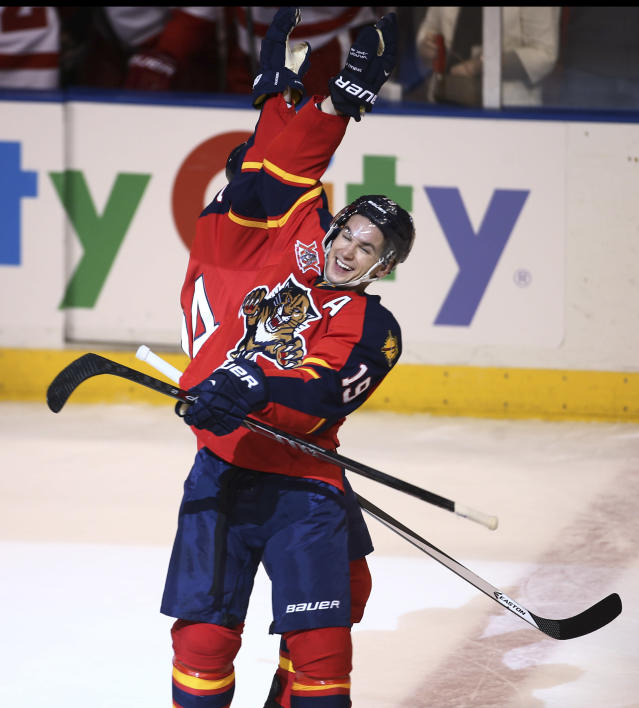 Florida Panthers' Scottie Upshall (19) celebrates with Brad Boyes (24) after Boyes scored the winning goal during the overtime shoot out of a NHL hockey game in Sunrise, Fla., Tuesday, Dec. 10, 2013 against the Detroit Red Wings. The Panthers won 3-2 in a shoot-out during overtime. (AP Photo/J Pat Carter)