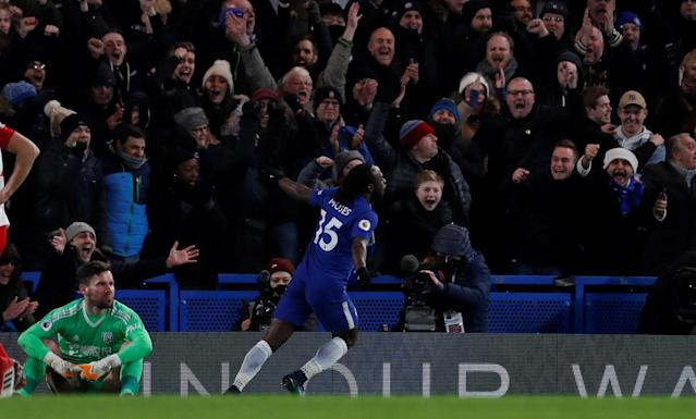 "Soccer Football - Premier League - Chelsea vs West Bromwich Albion - Stamford Bridge, London, Britain - February 12, 2018 Chelsea's Victor Moses celebrates scoring their second goal as West Bromwich Albion's Ben Foster looks dejected Action Images via Reuters/Andrew Couldridge EDITORIAL USE ONLY. No use with unauthorized audio, video, data, fixture lists, club/league logos or ""live"" services. Online in-match use limited to 75 images, no video emulation. No use in betting, games or single club/league/player publications. Please contact your account representative for further details."