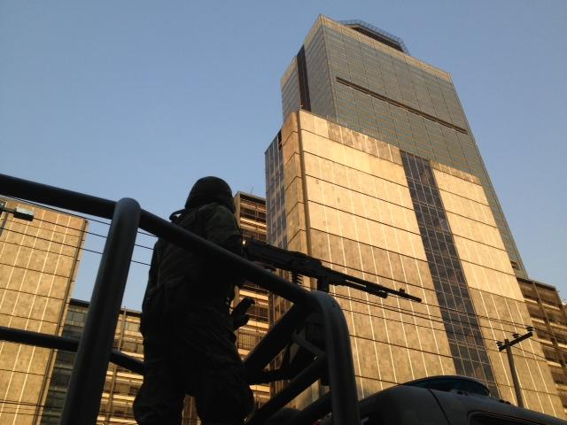 A soldier stands guard outside the Pemex headquarters after an explosion in Mexico City, Thursday, Jan. 31, 2013. Mexico's stated-owned oil company says an explosion at its headquarters in the capital has left several workers injured. (AP Photo/Eduardo Verdugo)