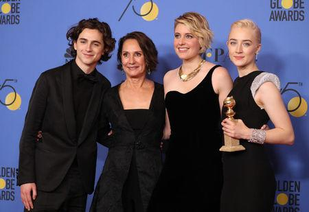 """75th Golden Globe Awards – Photo Room – Beverly Hills, California, U.S., 07/01/2018 – (L-R) Timothee Chalamet, Laurie Metcalf, Greta Gerwig and Saoirse Ronan pose backstage with their Best Motion Picture -Musical or Comedy award for 'Lady Bird."""" REUTERS/Lucy Nicholson"""