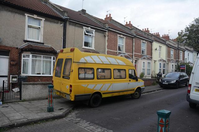 The van is parked on a residential street: Bristol Post/SWNS.com