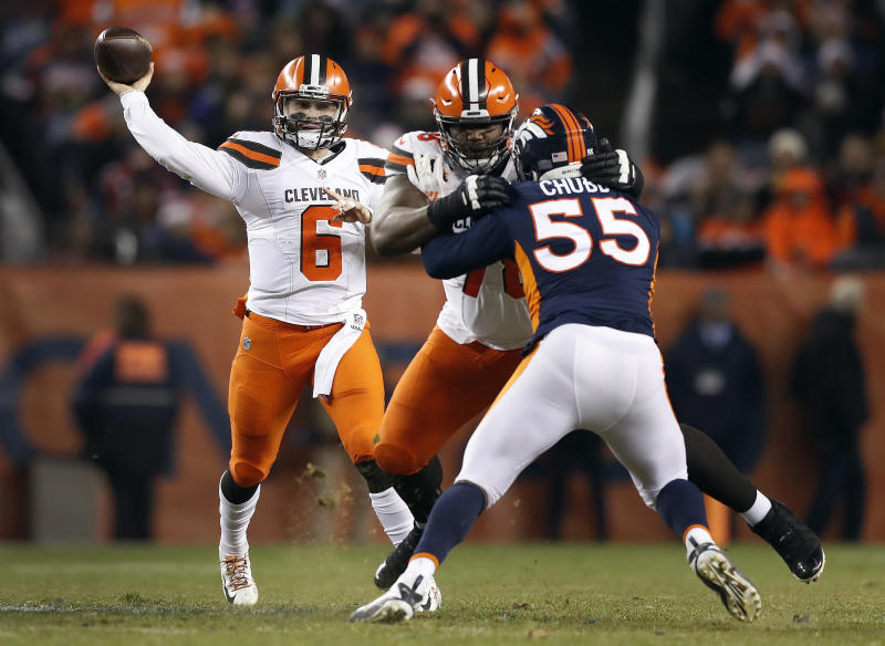 Cleveland Browns quarterback Baker Mayfield (6) throws as Denver Broncos outside linebacker Bradley Chubb (55) pursues during the second half of an NFL football game, Saturday, Dec. 15, 2018, in Denver. (AP Photo/Jack Dempsey)