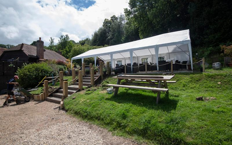 New steps, new marquee, and a hand sanitiser station to greet customers are among the changes - Julian Simmonds/The Telegraph