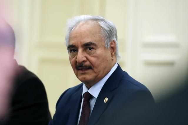 FILE - In this Jan. 17, 2020 file photo, Libyan Gen. Khalifa Hifter joins a meeting with the Greek Foreign Minister Nikos Dendias in Athens. The Libyan commander who launched an offensive last year to capture the capital Tripoli from the U.N.-recognized rival government has threatened to use force against Turkish troops if Ankara does not stop interfering in the war-stricken North African country. Hifter's comments come in response to the Turkish parliament's decision to extend for 18 months a law that allows the deployment of Turkish troops to Libya. (AP Photo/Thanassis Stavrakis, File)