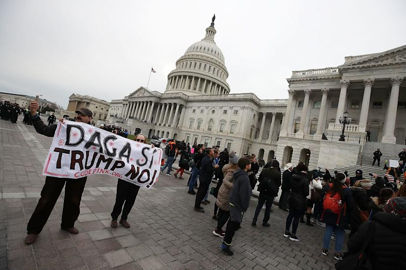 """Dreamers"" protest in front of the Capitol to urge Congress to spare the Deferred Action for Childhood Arrivals program on Dec. 6. (Mark Wilson via Getty Images)"