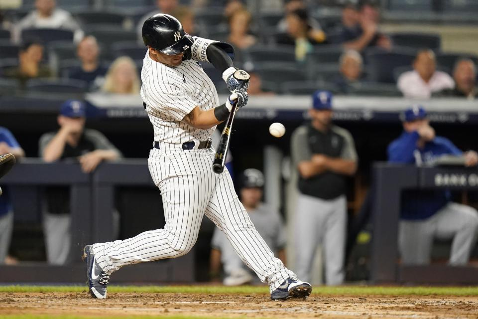 New York Yankees' Gleyber Torres hits an RBI-single during the third inning of a baseball game against the Texas Rangers, Monday, Sept. 20, 2021, in New York. (AP Photo/Frank Franklin II)
