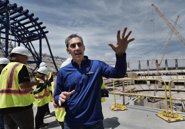 Kevin Demoff, Chief Operating Officer & Executive Vice President of Football Operations with the Los Angeles Rams, joins a media tour of the new NFL football Los Angeles Stadium under construction in Inglewood, Calif., Monday April 15, 2019. Stadium officials hosted a tour for the media after the final piece of the canopy structure to hold the roof was completed. (AP Photo/Richard Vogel)