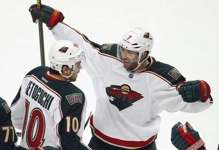 Wild's Setoguchi celebrates his goal with Cullen against Blackhawks during the second period of Game 2 of their NHL Western Conference Quarterfinals hockey game in Chicago