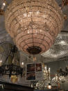 """This Oct. 15, 2019 photo shows salvaged light fixtures available for sale at Olde Good Things salvage store in New York. Two of the hottest trends in home decor are sustainability and authenticity. """"It's about both history and sustainability,"""" says Madeline Beauchamp of Olde Good Things, one of the oldest architectural salvage businesses in the country, with one shop in Los Angeles, another in Scranton, Pennsylvania, two stores in New York, and a flagship store to open soon in Midtown Manhattan. (Katherine Roth via AP)"""