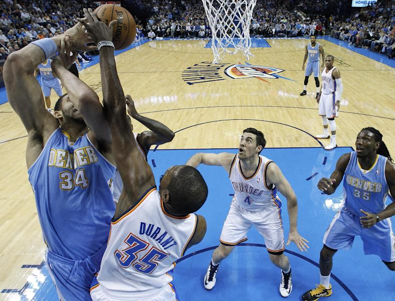 Oklahoma City Thunder forward Kevin Durant (35) blocks a shot by Denver Nuggets center JaVale McGee (34) in front of Thunder forward Nick Collison (4) and Nuggets forward Kenneth Faried (35) in the first quarter of an NBA basketball game in Oklahoma City, Tuesday, March 19, 2013. (AP Photo/Sue Ogrocki)