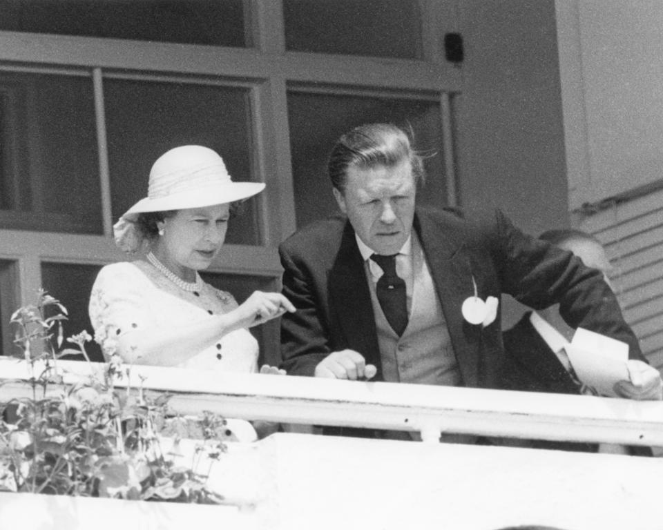 Queen Elizabeth II and her stud manager Sir Michael Oswald, watching the Derby at Epsom Downs Racecourse, Surrey, 4th June 1980. (Photo by Wesley/Keystone/Hulton Archive/Getty Images)
