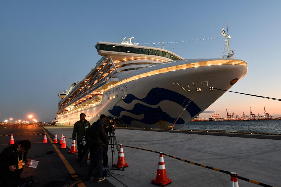 The Diamond Princess cruise ship, with over 3,700 people quarantined onboard due to fears of the new coronavirus, is seen anchored at the Daikoku Pier Cruise Terminal in Yokohama port on February 6, 2020. - Thousands of people were stranded aboard two cruise ships in Asia on February 6, quarantined by officials desperate to stem the spread of a deadly virus that has killed hundreds in China and spread panic worldwide. (Photo by Kazuhiro NOGI / AFP) (Photo by KAZUHIRO NOGI/AFP via Getty Images)