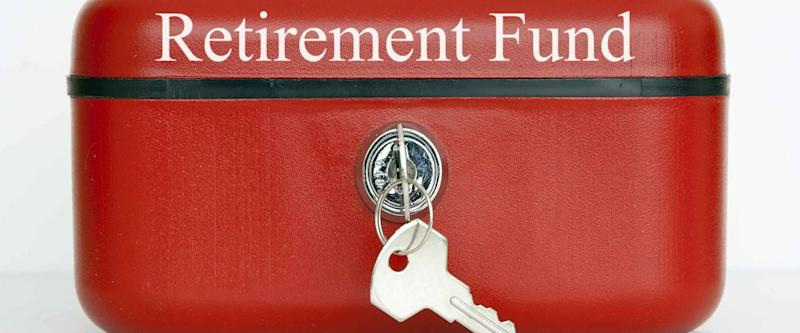 A closed red metal cash tin with Retirement Fund notice against a white background